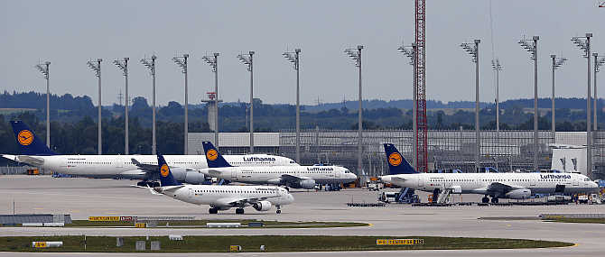 Lufthansa planes stand on the tarmac at Munich's international airport, Germany.