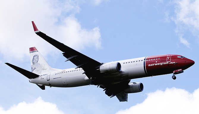 A Norwegian Air plane in the air near Oslo Airport in Norway.