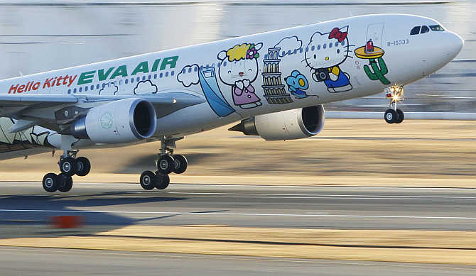 Eva Airways aircraft painted with Hello Kitty characters takes off at Narita International Airport in Narita, east of Tokyo, Japan.