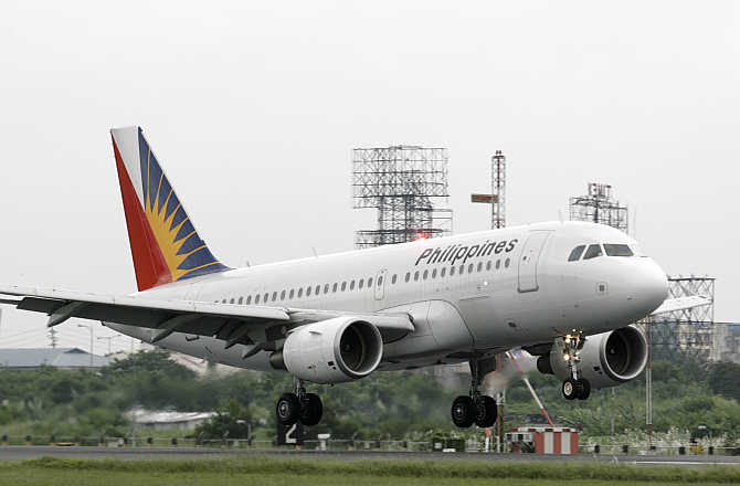 A Philippines Airline plane lands at Manila's airport in the Philippines.