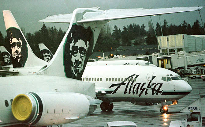 Alaska Airlines planes at a terminal at SeaTac Airport in Seattle, Washington, United States.