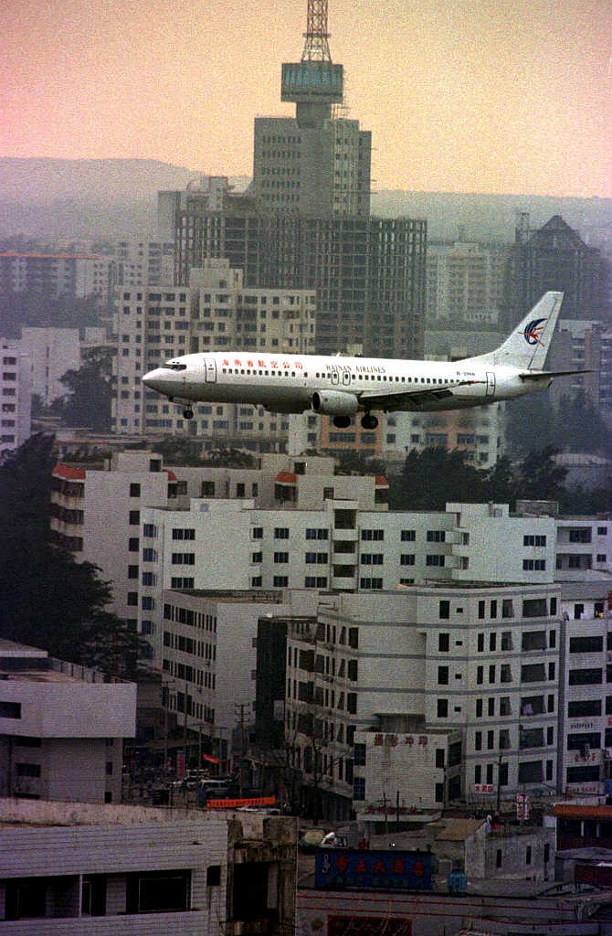 A Hainan Airlines Boeing prepares to land at Haikou, capital of the southern island province of Hainan, China.