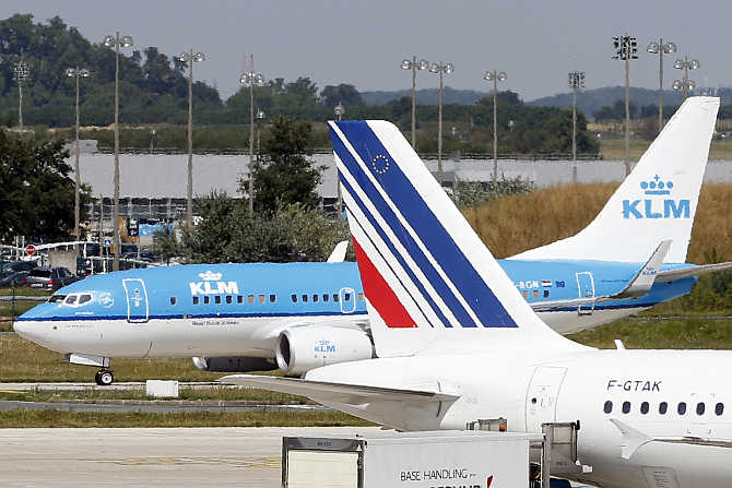 A KLM airline passenger jet rolls behind an Air France plane at the Charles de Gaulle International Airport in Roissy, near Paris, France.