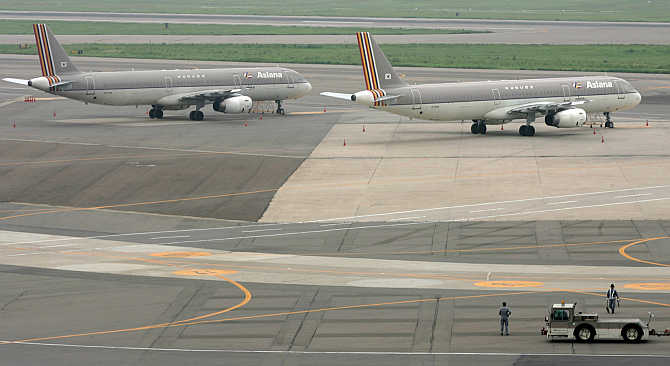 Asiana Airlines planes are parked at a tarmac of Kimpo airport in Seoul, South Korea.