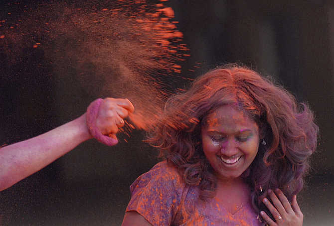 Colour is thrown on a girl during Holi celebrations in Chennai. Tamil Nadu is the third-most developed state.