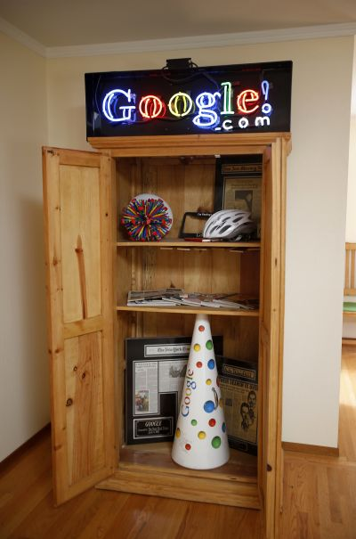 A shelve of Google-themed artifacts are seen at the house where the company was founded on Google's 15th anniversary in Menlo Park, California.