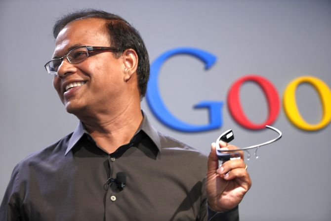 Amit Singhal, senior vice president of search at Google, holds a Google Glass as he speaks at the garage where the company was founded.