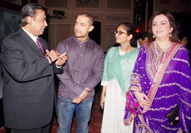 Mukesh Ambani (left), chairman of Reliance Industries, talks with Bollywood actor Aamir Khan and his wife Kiran Rao, as Ambani's wife Nita (right) watches, during the Real Heroes Awards ceremony in Mumbai.