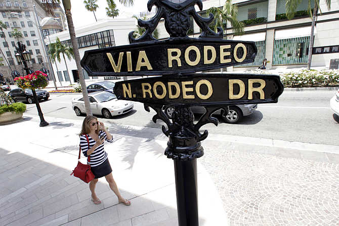 A woman walks along Rodeo Drive in Beverly Hills, California, United States.