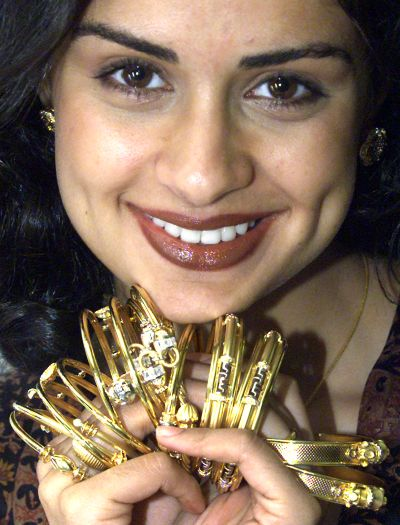 Gul Panag, Miss India in 1999, promotes a collection of gold jewellery in New Delhi.