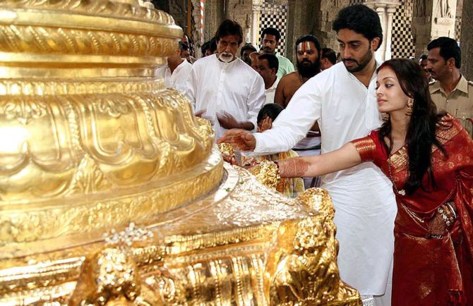 Bollywood star Abhishek Bachchan (3rd R) and his wife, actress Aishwarya Rai (2nd R), perform prayers at Tirumala Tirupati Devasthanam temple shrine in Tirumala.