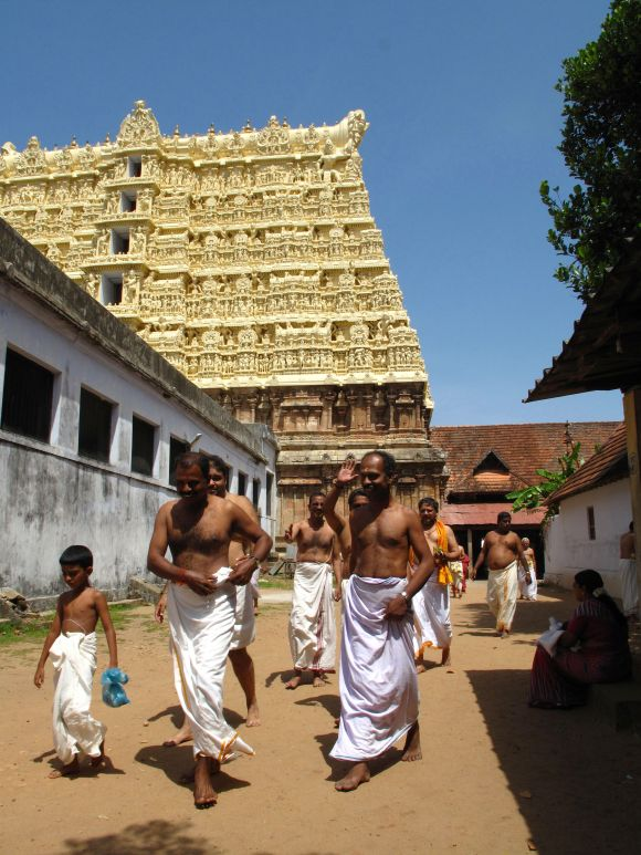 Hindu devotees in white cotton mundus visit the Sree Padmanabhaswamy temple in Kerala state in southern India.