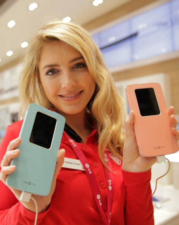 model holds LG smartphones.