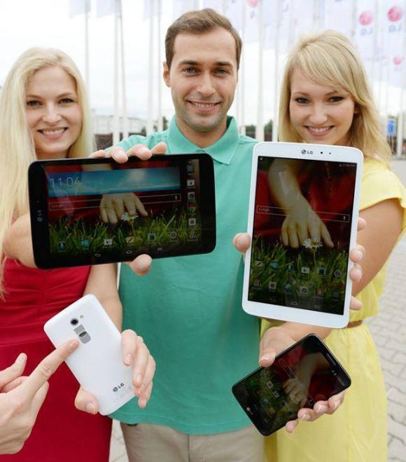 Models hold various LG smartphones.