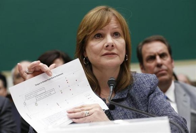 General Motors (GM) Chief Executive Mary Barra displays a document as she testifies before a House Energy and Commerce Committee hearing on GM's recall of defective ignition switches.
