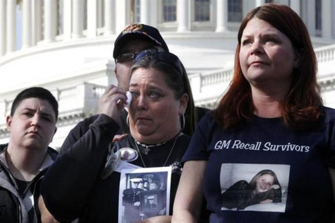 Crash survivor Samantha Denti and grieving mothers Kim Langley and Laura Christian join fellow family members of victims of the GM recall failure for a news conference on the U.S. Capitol grounds in Washington.