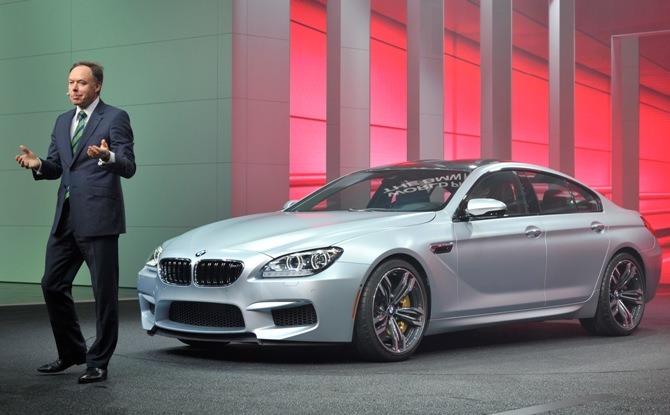 Dr Ian Robertson, of the BMW Board of Management, speaks next to the M6 Series Gran Coupe at the North American International Auto Show in Detroit, Michigan.