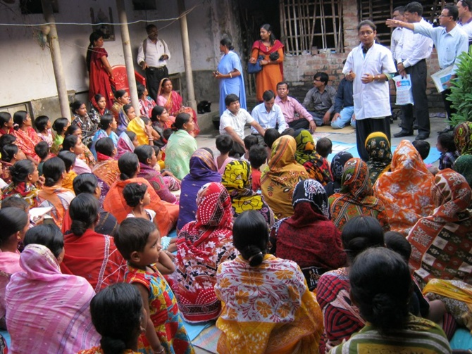 Bandhan employees talk to rural people.