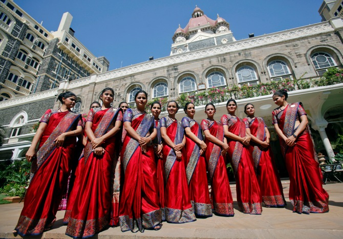 Staff of the Taj Mahal Palace hotel pose for a photo during a photo call in Mumbai.