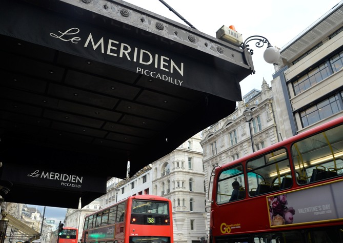 London buses pass 'Le Meridien Piccadilly' hotel, owned by Starwood Hotels, in Leicester Square in central London.