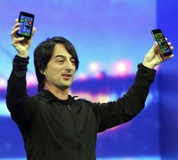 oe Belfiore, vice president of the operating system group at Microsoft, holds a pair of mobile phones featuring the new Windows 8.1 operating system.