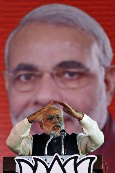 Hindu nationalist Narendra Modi, prime ministerial candidate for India's main opposition Bharatiya Janata Party (BJP) and Gujarat's chief minister, gestures as he speaks during their national council meeting at Ramlila ground in New Delhi.