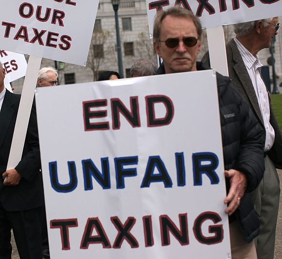Demonstrators protest against taxes.