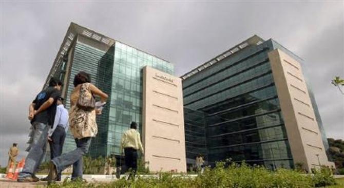 Employees walk near Microsoft India Development Center in Hyderabad