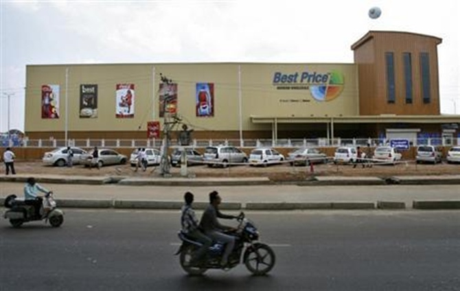 Two-wheelers move past the newly opened Bharti Wal-Mart Best Price Modern wholesale store in Hyderabad.