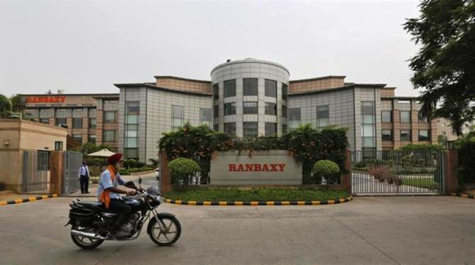 A man rides a motorcycle in front of the office of Ranbaxy Laboratories at Gurgaon, on the outskirts of New Delhi.