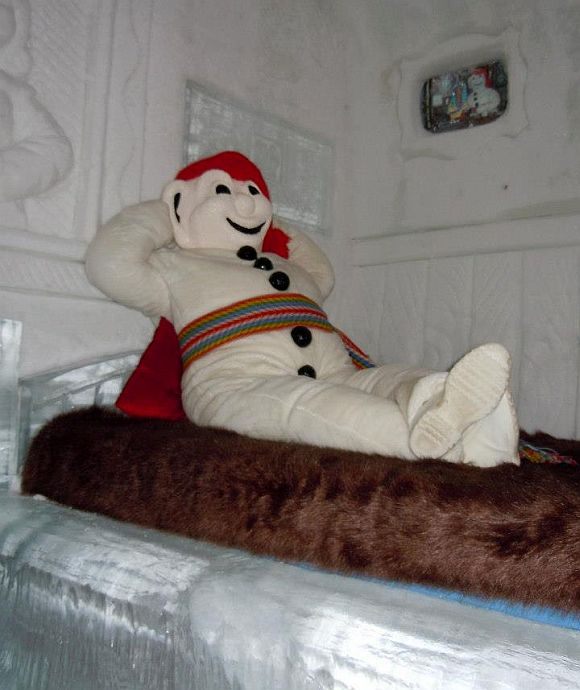 A snowman resting inside guest accommodation at the Hotel de Glace.