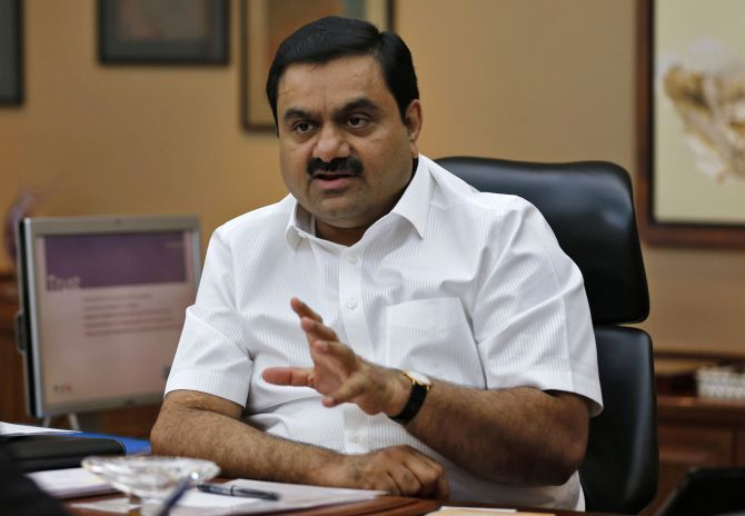 Indian billionaire Gautam Adani speaks during an interview with Reuters.
