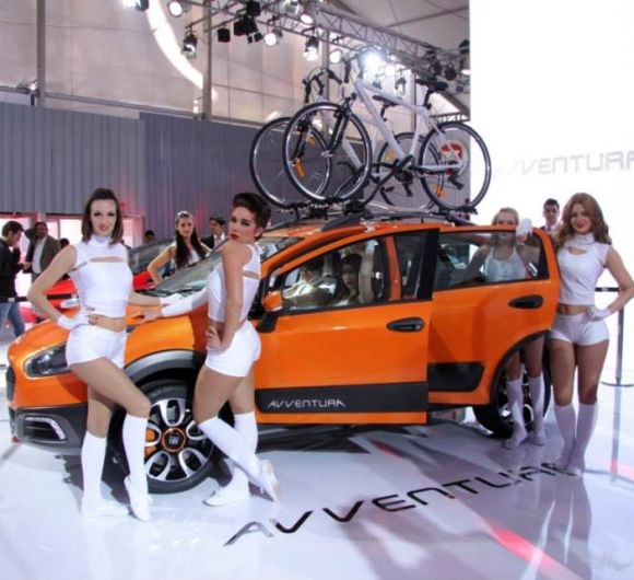 Models display Fiat Punto Avventura at the Indian Auto Expo.