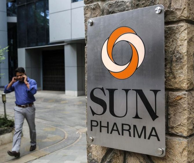 An employee speaks on phone as he walks out of research and development centre of Sun Pharmaceutical Industries.
