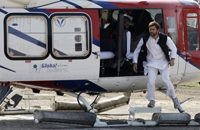 Rahul Gandhi hops out of a helicopter during his election campaign in UP