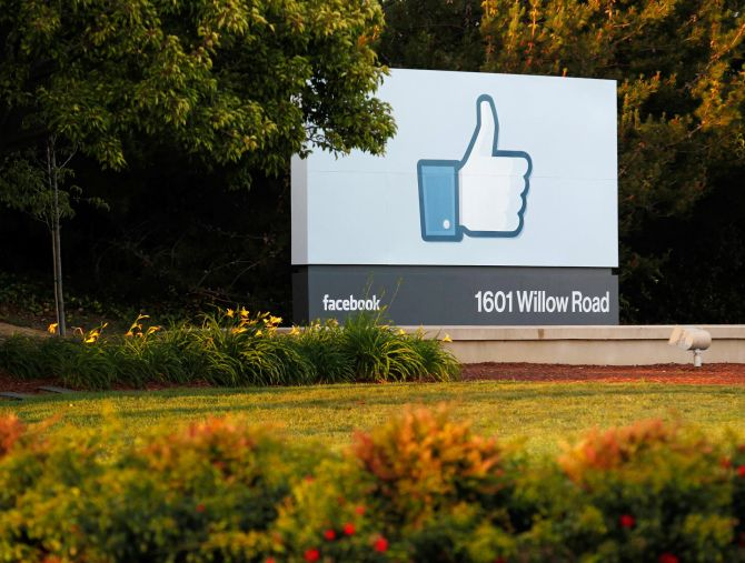The sun sets on the entrance sign at Facebook's headquarters in Menlo Park, California.