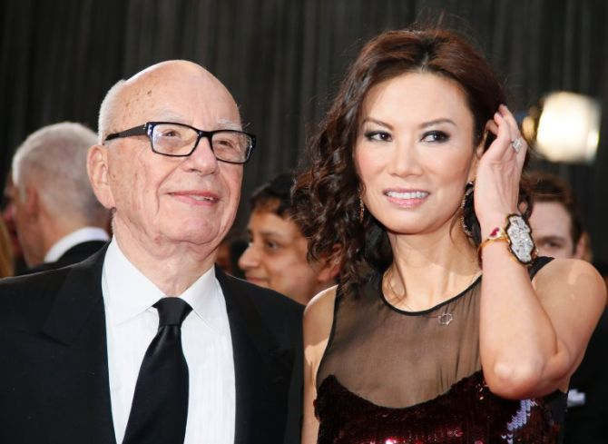 Rupert Murdoch, chairman and CEO of News Corporation, arrives with his wife Wendi Deng at the 85th Academy Awards in Hollywood.