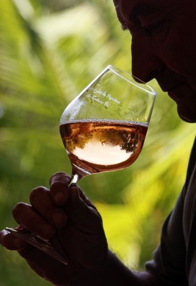 A man tries out rose wine.
