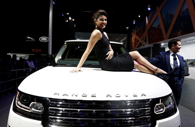Actress Priyanka Chopra poses with Jaguar Land Rover's Range Rover LWB during its launch.