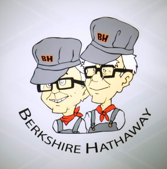 Berkshire Hathaway chairman Warren Buffet (R) and vice-chairman Charlie Munger are depicted as railroad engineers on a sign at the Borsheims jewellery store in Omaha.