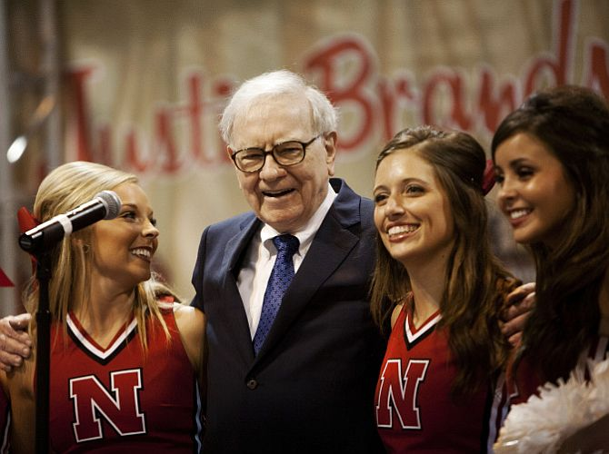Warren Buffett sings with University of Nebraska cheerleaders during the Berkshire Hathaway Annual shareholders meeting in Omaha.