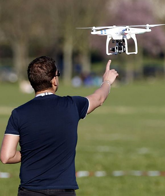 A pilot flies a drone.