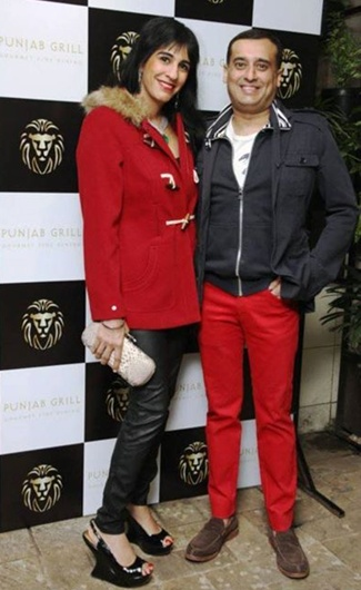 Amit Burman with wife Divya.