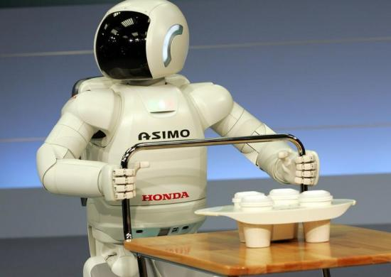 Asimo pushes a cart at the Honda headquarters in Tokyo.