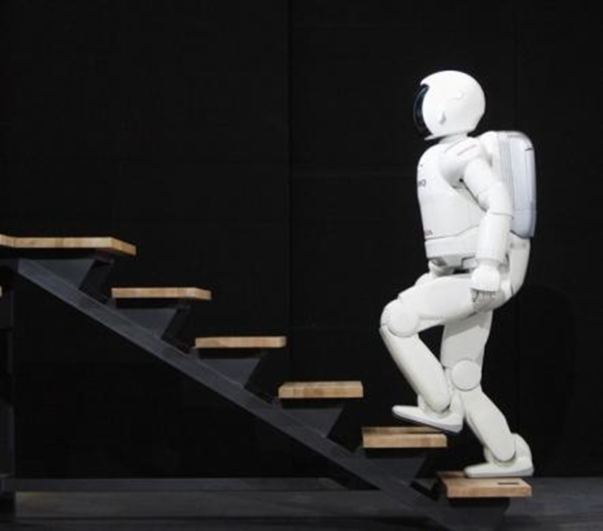 Honda's second version of the humanoid robot Asimo climbs a flight of stairs in Barcelona.