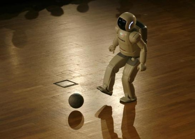 Asimo plays a ball during a presentation at the university of Bielefeld during its first appearance in Germany.
