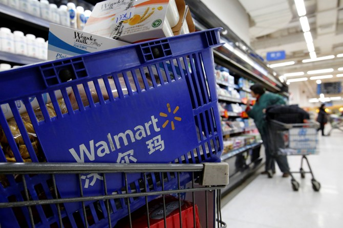 A shopping cart full of products is seen as a customer shops at a Wal-Mart store.