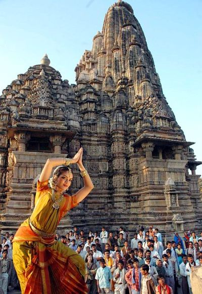 Rukmini Vijay Kumar, Indian classical dancer of Bharatnatyam, poses against the backdrop of the renowned Khajuraho temple.