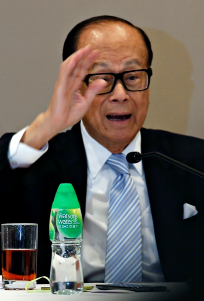 Hutchison Whampoa Chairman Li Ka-Shing reacts during a news conference in Hong Kong.