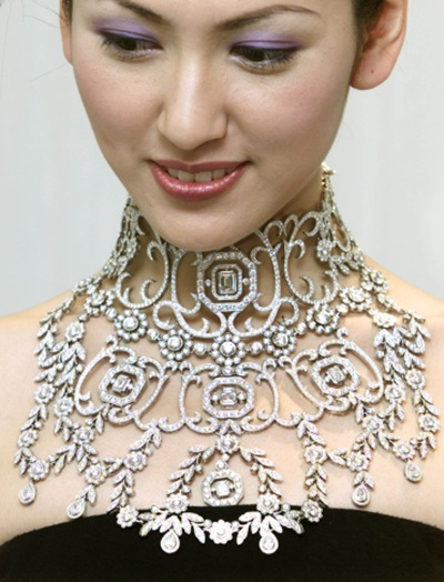 A model displays a diamond necklace.